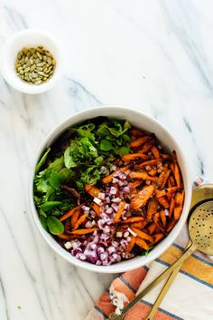 This striking salad combines tender roasted carrots, protein-rich lentils and fresh greens and mint with a garam masala-infused vinaigrette. #vegansalad #healthysalad #lentilrecipe