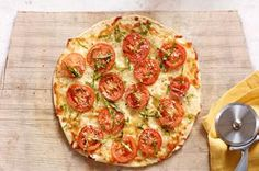 Tortilla Pizza Margherita recipe - Love the aroma of basil and garlic in the kitchen? Our homemade margherita pizza is an easy weeknight dish when you make it with a flour tortilla.