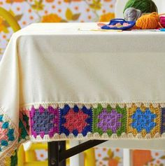 Crochet a granny square tablecloth. Only I would use crochet thread in muted colors. In fact, maybe I will. Crochet Diy, Crochet Motifs, Crochet Borders, Crochet Squares, Crochet Home, Love Crochet, Crochet Crafts, Crochet Doilies, Yarn Crafts