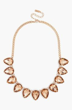 Love the pretty peach crystals on this necklace.