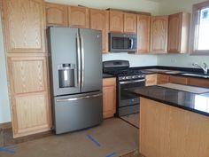 GE Slate Appliances In Kitchen With Golden Oak Cabinets