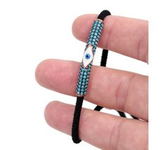 Evil eye bracelet with enamel evil eye and black cord. Nano turquoise evil eye bracelet with enamel evil eye and adjustable black cord. Evil eye bracelet to protect you against the evil spirits. Evil Eye Jewelry, Evil Eye Bracelet, Evil Spirits, Turquoise Stone, Enamel, Watches, Eyes, Bracelets, Silver
