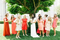 Neat! What a cool idea to have different dresses along a similar color scheme.