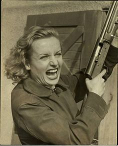 Carole Lombard.  I have no idea which movie this was, but I don't think I'd want to cross *that* woman!!!
