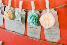 Escort cards with printed questions about the couple with corresponding table number. The guest name will be places weeks before the wedding; & the list of questions to be printed by the invitation printer.