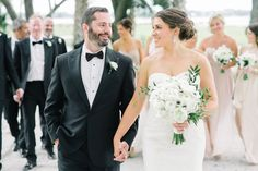 Bride and Groom walking with wedding party following behind.  Wedding Planner | Mac & B Events >> Photography | Aaron and Jillian Photography
