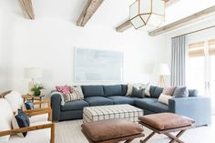 Living room remodel in a California home. Living room design and inspo. Wood beams, dark wood floors, white walls. Living room seating. | Studio McGee Blog