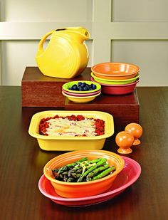 Fiesta® Dinnerware and Bakeware. Sunflower, Tangerine, and Flamingo (retired).