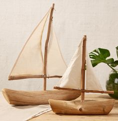 """This sailboat is made out of driftwood and is handcrafted by a skilled  artisan. As in nature, no two pieces will be exactly alike. Small splits  and cracks which can occur over time, are inherent and a natural  characteristic of the material. Each piece is unique and will vary. They  are truly beautiful and at home in either a boy's room or a beach house.  This listing is for one sailboat, the small one.  small:12""""W x 3""""D x 13 1/2""""H"""