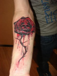 "damn this tattoo is awesome... bleeding rose with ""hidden"" skull"