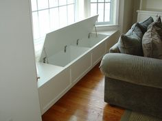 Window seat with storage - good idea for the bay in the dining room. I can store all the table cloths, napkins, place mats, etc, there! Add cushions for seating in the meantime. More room design storage 3 Creative Storage Solutions for the Family Room Traditional Family Rooms, Traditional Design, Window Benches, Bay Window Seating, Window Table, Window Seat Kitchen, Bay Window Cost, Window Sill, Sunroom Window Treatments