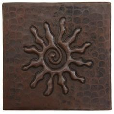 Hammered Copper Tile by Hammermarc. $7.50. INF: This unique sun design spirals in a labyrinth like pattern to create a fascinating look for your copper sink backsplash or wall and floor accent. Created by hand with an artisans careful touch, this design is certain to brighten up your day! Hand Hammered Copper Tile. Fleur De Lis Design. Sold Individually. Hand Hammered with ceramic tile backers. This tile is not currently kept in stock, allow 4 weeks for delivery.