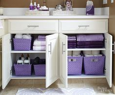 Ditch your mismatched bins and baskets in favor of colorful designs that coordinate. These purple baskets add a pop of color to the undersink area and match bath towels and accessories. Look for containers that can stand up to moisture and are easy to clean.