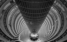 Flipping his usual style upside down, the professional photographer managed to capture this dizzying shot looking downwards from inside another of Shanghai's skyscrapers