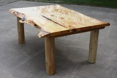 White Pine slab top dining table with live edges and white cedar legs.