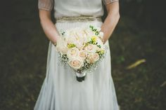 Peach Rose Bridal Bouquet | Powder Blue Maids to Measure Bridesmaid dresses | Sarah Janks Wedding Dress | Rustic Wedding In Ireland At Darver Castle | Images by Paula Gillespie | http://www.rockmywedding.co.uk/eimear-dave/