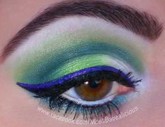 Wearing BFTE Cosmetics eyeshadows in Bombshell, Tropical & Envy.  Also, Sugarpill Cosmetics in Tako & Midori.  Sephora eye primer.  NYX milk jumbo pencil, liquid eyeliner in black & extreme purple.  Jordana white pencil liner.  Waterproof Falsies mascara.  Eyebrows filled in with Rimmel black/brown pencil brow liner.  www.facebook.com/mostbabealicious    smokey, edgy, colorful eyeshadow makeup. cat, winged eyeliner