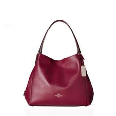 NWT Coach Handbag Black Cherry!!! The new Coach Edie 31  handbag combines easy, modern elegance with great utility. The latest iteration of a beloved Coach silhouette, her soft, slouchy pebbled-leather exterior conceals a three-compartment interior designed for perfect organization.   Made of Pebble Leather Zip-top closure Inside zip, cell phone and multifunction pockets Handbag Material: Leather Handbag Color: Black Cherry Main Closure Coach Bags Shoulder Bags
