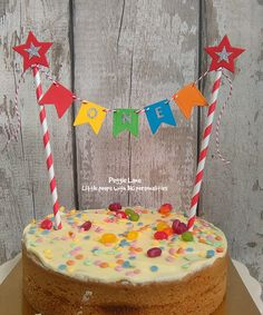 This 1st Birthday cake bunting is sure to add a extra bit of pizzazz to your little ones Birthday cake! or maybe your looking for a photo prop then this cake smash bunting might be just the thing!  Your little star has reached their 1st milestone, its time to celebrate! Handcrafted Rainbow cake bunting made from bright coloured card stock, embellished with the wording one cut from sparkly cardstock just adds that extra bit of glam! Of course I had to add a little star because in a parents…