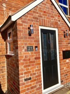 A bespoke modern composite door with solid timber core and composite porch windows