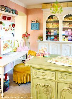Craft room - I imagine mine like this, warm, bright, girly and on the other side of the wall an comfy love seat and coffee table in case anyone wants to hang out while I get my craft on.