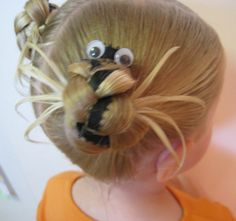 There's a spider in her hair! Cute for Halloween :)