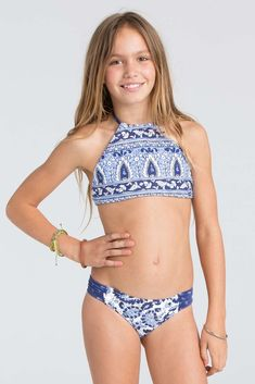 4348055e05c34 This pretty print reverses to solid for a 2-in-1 top. The high neck bikini  top is our pick for stay-put.