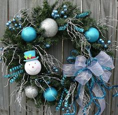 Winter Snowman Wreath - Blue and Silver Wreath for use all Winter Long - Fun Winter Wreath with Bow via Etsy.