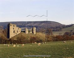 CLUN CASTLE, near Ludlow, Shropshire. General view of the castle showing its picturesque surroundings and extensive earthworks. The Keep of this Welsh Border Castle is unusually positioned on the side of its mound