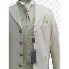 no silver buttons - but I like the idea of textured fabric for vest and tie