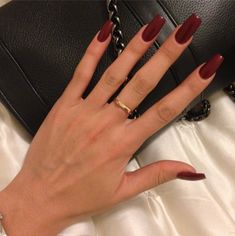 "If you're unfamiliar with nail trends and you hear the words ""coffin nails,"" what comes to mind? It's not nails with coffins drawn on them. It's long nails with a square tip, and the look has. Dark Nails, Long Nails, My Nails, Dark Color Nails, Nice Nails, Red Acrylic Nails, Acrylic Nail Designs, Winter Acrylic Nails, Tumblr Acrylic Nails"