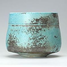 I love the soda ash effect and tiny foot on this substantial bowl.  Turquoise/orange ribbed bowl by Jack Doherty