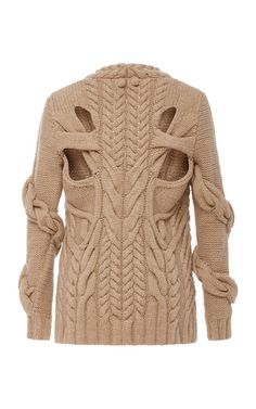 For a chic option in colder months, opt for this **Nillie Lotan** pullover with intricate knitting at the front and 3D effect at the arms. Rendered completely in premium wool and cashmere blend, you will surely keep warm.