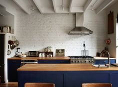 All I want out of life are navy cabinets with natural butcher block countertops! It's so soothing to me.