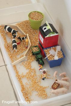 , Farm Sensory Play for Preschoolers - An orange juice container makes a simple grain silo that. , Farm Sensory Play for Preschoolers - An orange juice container makes a simple grain silo that really loads corn into a toy tractor! Farm Sensory Bin, Sensory Table, Sensory Play, Toddler Sensory Bins, Sensory Boxes, Toddler Play, Sensory Diet, Farm Activities, Preschool Activities