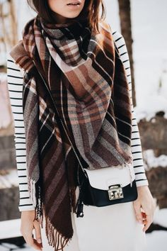 Black and white striped top with cute plaid scarf.