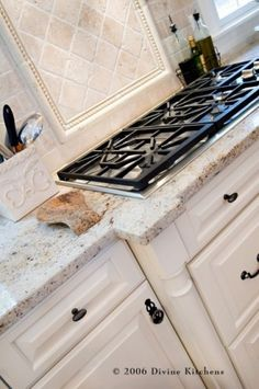 traditional kitchen by Divine Kitchens LLC Kashmir white granite. stone backsplash