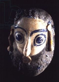 Bearded head pendant, from Carthage, Tunisia, Phoenician, 4th-3rd century BC (sand-core glass) lLouvre