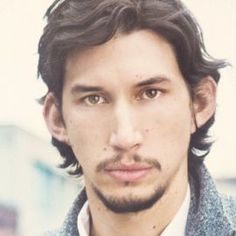 Young Adam Driver with beard and shortish hair.