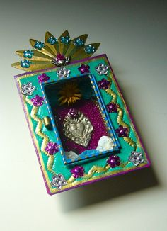 Turquoise, gold and pink Mexican tin nicho