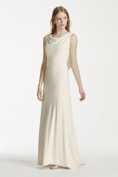 Render your guests speechless in this elegantly chic and breathtaking pearl and chain accented jersey gown!   A nod to old-world glamour, this jersey sheath high-cowl neck gown provides the perfect touch of elegance.  Back cowl draping is accented with pearl and chain back design, adding a stunning visual effect flattering on any figure.  No train. Sizes 2-18.  Available in Ivory online only.  Fully lined.
