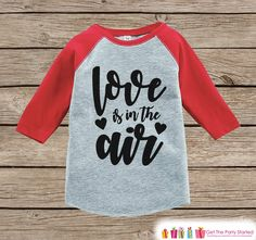 Now available on our store: Kids Valentines O.... Check it out here! http://7ate9apparel.com/products/kids-valentines-outfit-love-is-in-the-air-valentine-shirt-or-onepiece-girls-valentines-day-shirt-baby-toddler-youth-red-raglan?utm_campaign=social_autopilot&utm_source=pin&utm_medium=pin