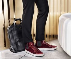 #HOGAN high-top sneakers H242 and tumbled leather backpack to complete a dandy-biker look.  Explore the #FW1415 Collection.