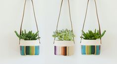 These small hanging canvas baskets are the perfect way to display your favorite plants, while brightening up any space in the house.