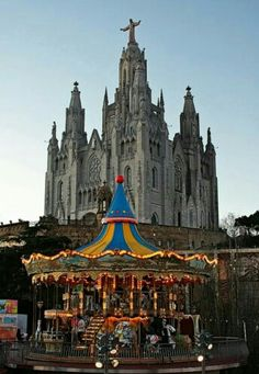 Tibidabo Church in Spain is juxtaposed against the Tibidabo carousel Oh The Places You'll Go, Places To Travel, Places To Visit, Hotel W, Europa Tour, Barcelona Catalonia, Barcelona Travel, Spain And Portugal, Place Of Worship