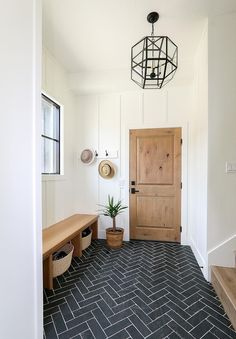Ideas: Lindsay Hill Interiors mudroom decor with bench and herringbone floor Interior Design Ideas: Lindsay Hill Interiors mudroom decor with bench and herringbone floor Designer - RTG Designs Planchers En Chevrons, Mudroom Laundry Room, Bench Mudroom, Hallway Bench, Foyer With Bench, Hallway Entrance Ideas, Ikea Hallway, Front Hallway, Garage Entry