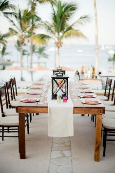Neutral with pops of bright color + lanterns.    Photography by Sara Richardson Photography Read more - http://www.stylemepretty.com/destination-weddings/2014/02/07/pink-cabo-san-lucas-wedding/