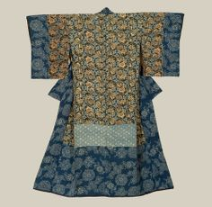 A silk inner antique kimono featuring hem fabric patterned using the katazome technique. 1840-1880, Japan.The Kimono Gallery