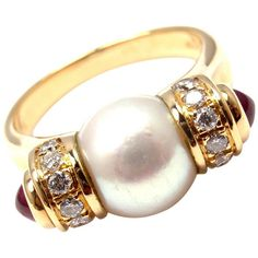 Bulgari Pearl Ruby Diamond Yellow Gold Ring. 18k Yellow Gold Diamond, Ruby & Pearl Ring by Bulgari. With 14 brilliant cut diamonds VS1 clarity, G color total weight approx. .20ct, 2 round cabochon rubies total weight approx. .20ct, 1 9mm pearl