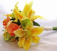 This Silk Bouquet has yellow tiger lilies, green calla lilies and orange orchids.